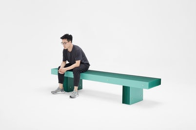 Grid Bench Green with Person Sitting