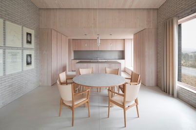 Wooden Interior with Dining Table and Chairs